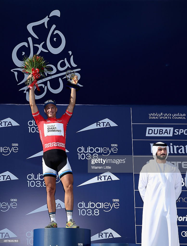 Marcel Kittel of Germany and Team Giant - Shimano celebrates after being presented the trophy by Sheikh Majed Bin Rashid al-Maktoum, son of Sheikh Mohammed Bin Rashid al-Maktoum ruler of Dubai looks on after winning stage four of the 2014 Dubai Tour on February 8, 2014 in Dubai, United Arab Emirates.
