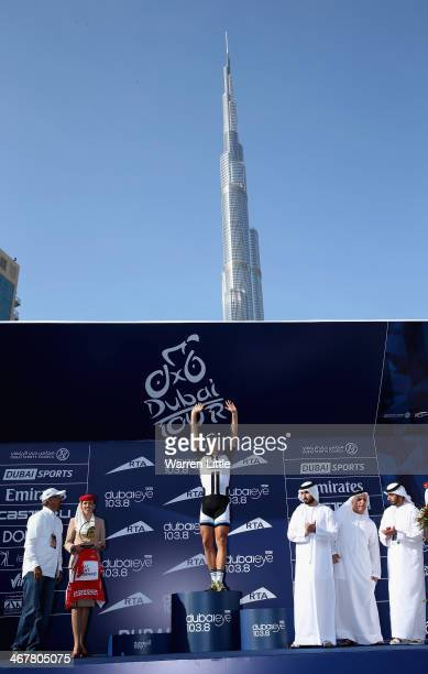 Marcel Kittel of Germany and Team Giant Shimano celebrates as Sheikh Majed Bin Rashid alMaktoum son of Sheikh Mohammed Bin Rashid alMaktoum ruler of...
