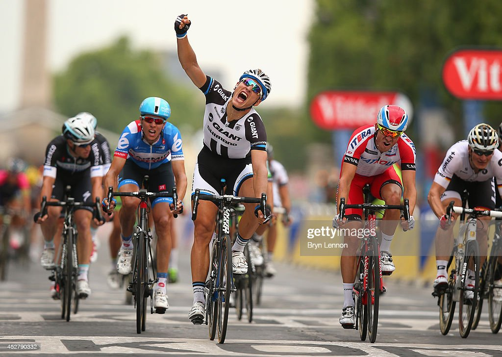<a gi-track='captionPersonalityLinkClicked' href=/galleries/search?phrase=Marcel+Kittel&family=editorial&specificpeople=4520423 ng-click='$event.stopPropagation()'>Marcel Kittel</a> of Germany and Team Giant-Shimano celebrates as he crosses the line to win the twenty first stage of the 2014 Tour de France, a 138km stage from Evry into the Champs-Elysees, on July 27, 2014 in Paris, France.
