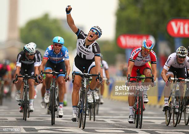 Marcel Kittel of Germany and Team GiantShimano celebrates as he crosses the line to win the twenty first stage of the 2014 Tour de France a 138km...