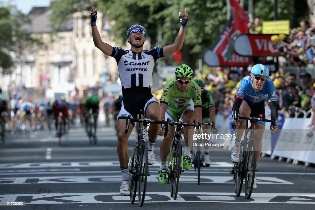 <a gi-track='captionPersonalityLinkClicked' href=/galleries/search?phrase=Marcel+Kittel&family=editorial&specificpeople=4520423 ng-click='$event.stopPropagation()'>Marcel Kittel</a> of Germany and Team Giant-Shimano celebrates his victory ahead of <a gi-track='captionPersonalityLinkClicked' href=/galleries/search?phrase=Peter+Sagan&family=editorial&specificpeople=4846179 ng-click='$event.stopPropagation()'>Peter Sagan</a> of Slovakia and Cannondale in second place and Ramunas Navardauskas of Lithuania and Garmin-Sharp in third place in stage one of the 2014 Tour de France from Leeds to Harrogate on July 5, 2014 in Harrogate, United Kingdom.