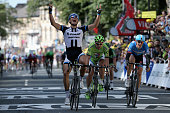 Marcel Kittel of Germany and Team GiantShimano celebrates his victory ahead of Peter Sagan of Slovakia and Cannondale in second place and Ramunas...