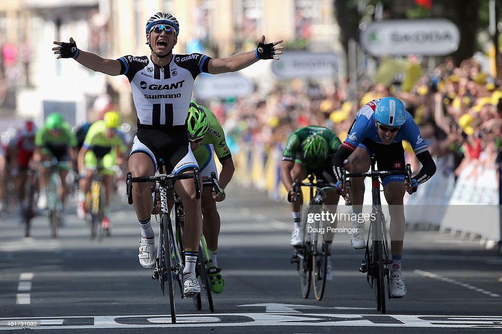 <a gi-track='captionPersonalityLinkClicked' href=/galleries/search?phrase=Marcel+Kittel&family=editorial&specificpeople=4520423 ng-click='$event.stopPropagation()'>Marcel Kittel</a> of Germany and Team Giant-Shimano celebrates his victory ahead of <a gi-track='captionPersonalityLinkClicked' href=/galleries/search?phrase=Peter+Sagan&family=editorial&specificpeople=4846179 ng-click='$event.stopPropagation()'>Peter Sagan</a> of Slovakia and Cannondale in second place, Ramunas Navardauskas of Lithuania and Garmin-Sharp in third place and <a gi-track='captionPersonalityLinkClicked' href=/galleries/search?phrase=Bryan+Coquard&family=editorial&specificpeople=8795501 ng-click='$event.stopPropagation()'>Bryan Coquard</a> of France and Team Europcar in fourth place in stage one of the 2014 Tour de France from Leeds to Harrogate on July 5, 2014 in Harrogate, United Kingdom.