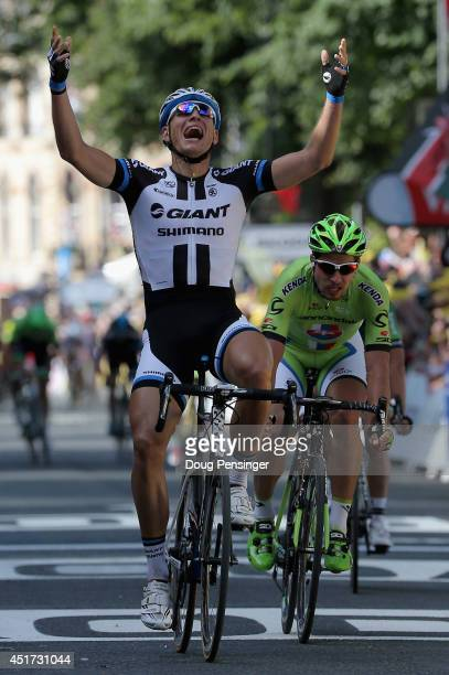 Marcel Kittel of Germany and Team GiantShimano celebrates his victory ahead of Peter Sagan of Slovakia and Cannondale in second place in stage one of...