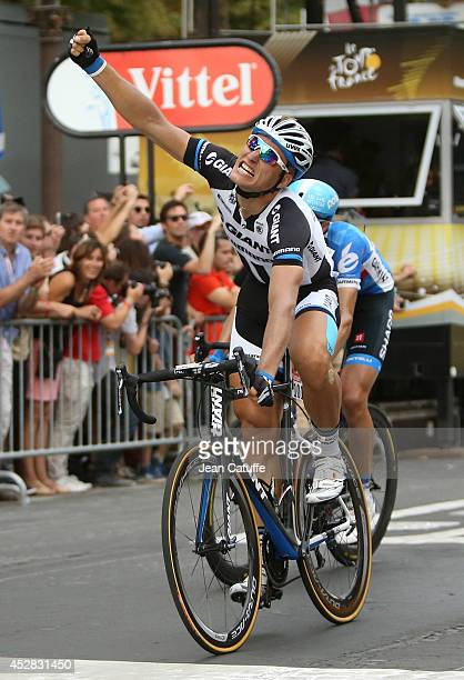 Marcel Kittel of Germany and Team GiantShimano celebrates winning the twenty one and last stage of the 2014 Tour de France a 134 km individual time...