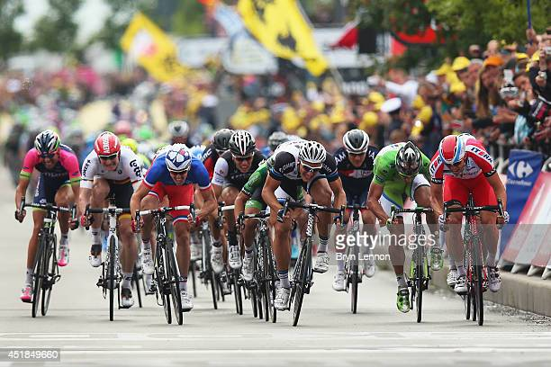 Marcel Kittel of Germany and Team GiantShimano sprints to win the fourth stage of the 2014 Tour de France a 163km stage between Le TouquetParisPlage...