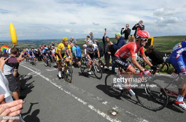 Marcel Kittel wears the yellow jersey as stage two of the Tour de France passes over Holme Moss Moor Yorkshire