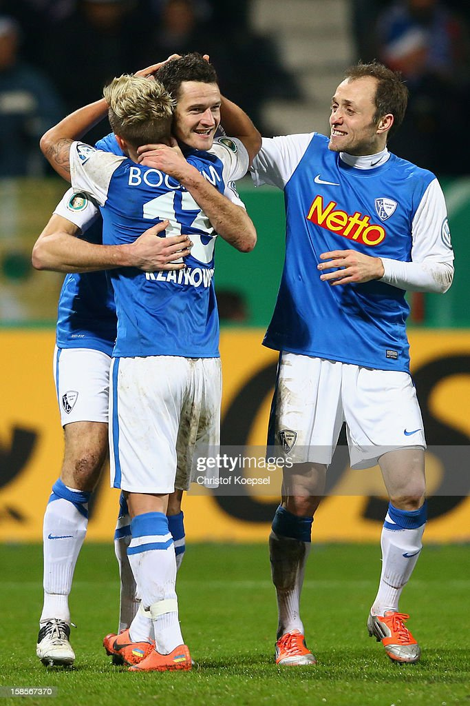 Marcel Maltritz of Bochum celebrates the second goal with Marc Rzatkowski and Alexander Iashvili during the DFB cup round of sixteen match between...