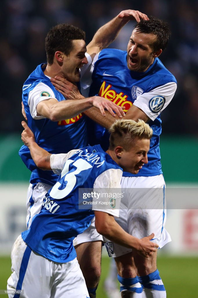 Marcel Maltritz of Bochum celebrates the third goal with Marc Rzatkowski and Christoph Dabrowski of Bochum during the DFB cup round of sixteen match...