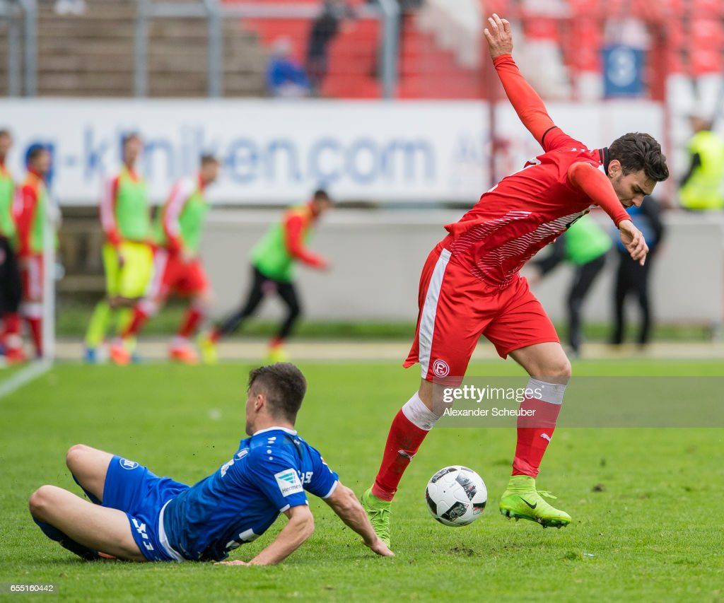 Marcel Mehlem of Karlsruhe challenges Kaan Ayhan of Fortuna Duesseldorf during the Second Bundesliga match between Karlsruher SC and Fortuna Duesseldorf at Wildparkstadion on March 19, 2017 in Karlsruhe, Germany.