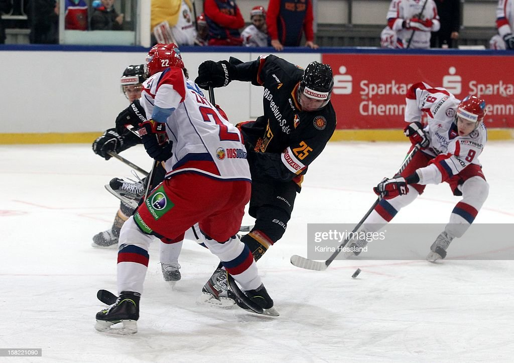Marcel Mueller of Germany challenges Nikita Zaitsev of Russia during the Top Teams Sochi match between Germany and Russia at Kuechwaldhalle on December 11, 2012 in Chemnitz, Germany.