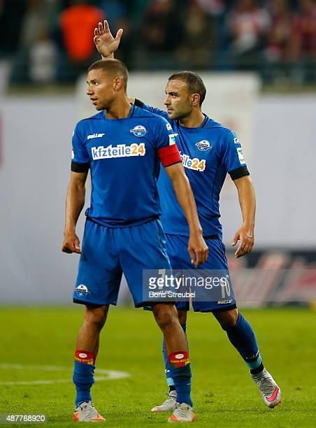 Marcel Ndjeng and Mahir Saglik of Paderborn react during the Second Bundesliga match between RB Leipzig and SC Paderborn at Red Bull Arena on...