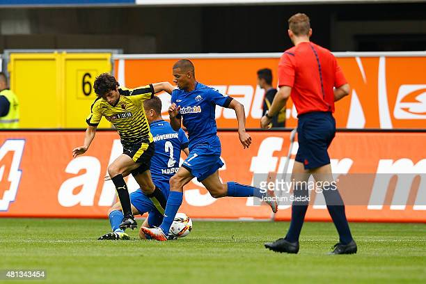 Marcel Ndjeng of Paderborn challenges Diego Fabbrini of Watford during the preseason friendly match between SC Paderborn and Watford FC at Benteler...