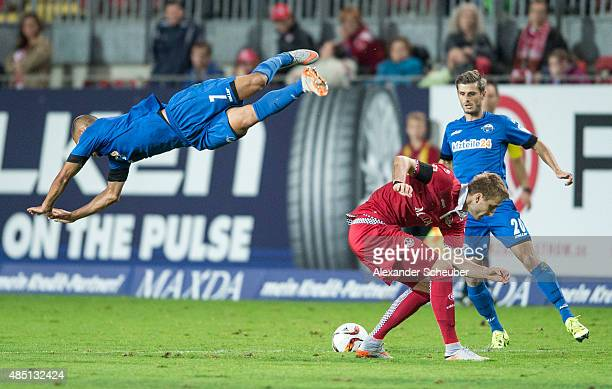 Marcel Ndjeng of SC Paderborn challenges Kacper Przybylko of 1 FC Kaiserslautern during the second Bundesliga match between 1 FC Kaiserslautern and...