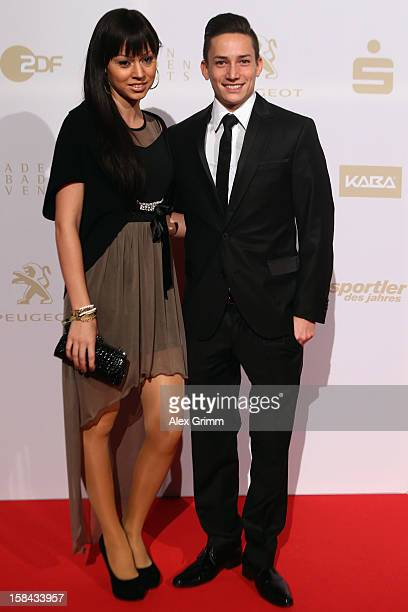 Marcel Nguyen and girl friend Alexa pose during the 'Athlete of the Year 2012' gala at the Kurhaus BadenBaden on December 16 2012 in BadenBaden...