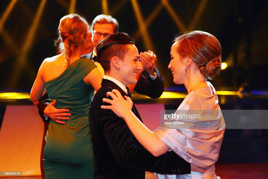 <a gi-track='captionPersonalityLinkClicked' href=/galleries/search?phrase=Marcel+Nguyen&family=editorial&specificpeople=241408 ng-click='$event.stopPropagation()'>Marcel Nguyen</a> dances with German Family Minister Kristina Schroeder during the 'Ball des Sports 2013' at Rhein-Main-Hallen on February 2, 2013 in Wiesbaden, Germany.