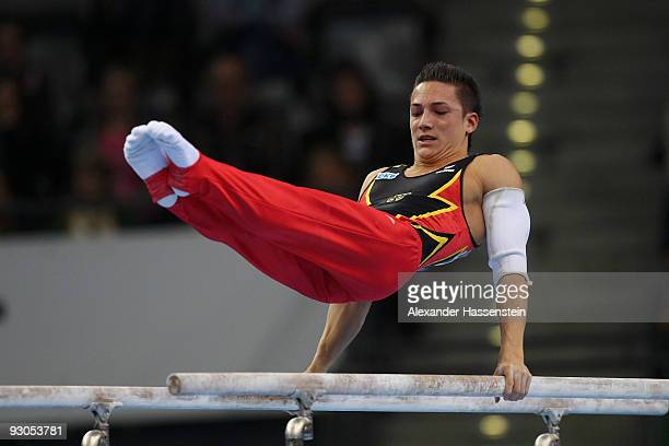 Marcel Nguyen of Germany competes at the Parallel bars during day one of the EnBW Gymnastics World Cup 2009 at the Porsche Arena on November 14 2009...