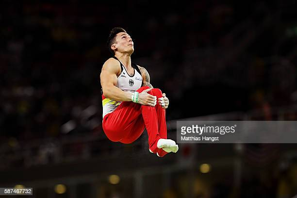 Marcel Nguyen of Germany competes on the horizontal bar during the men's team final on Day 3 of the Rio 2016 Olympic Games at the Rio Olympic Arena...