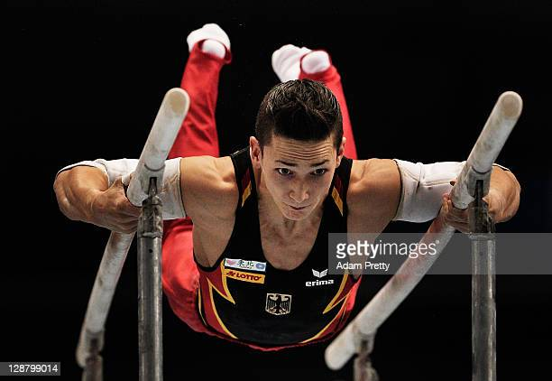 Marcel Nguyen of Germany competes on the Parallel Bars aparatus in the Men's qualification during day three of the Artistic Gymnastics World...