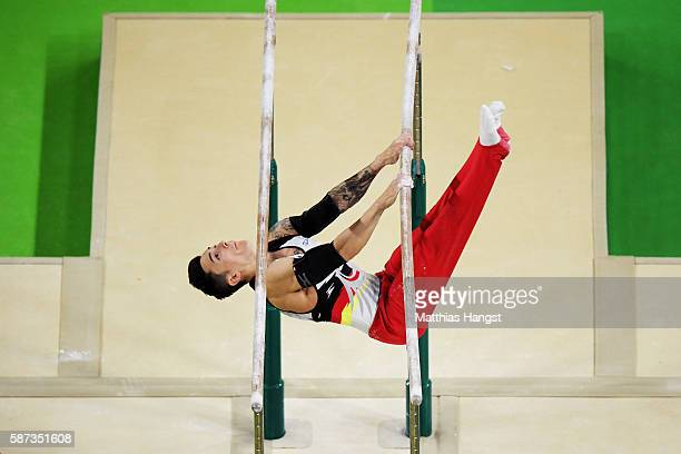 Marcel Nguyen of Germany competes on the parallel bars during the men's team final on Day 3 of the Rio 2016 Olympic Games at the Rio Olympic Arena on...