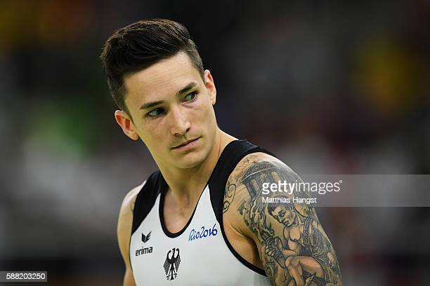 Marcel Nguyen of Germany looks on during the Men's Individual AllAround final on Day 5 of the Rio 2016 Olympic Games at the Rio Olympic Arena on...