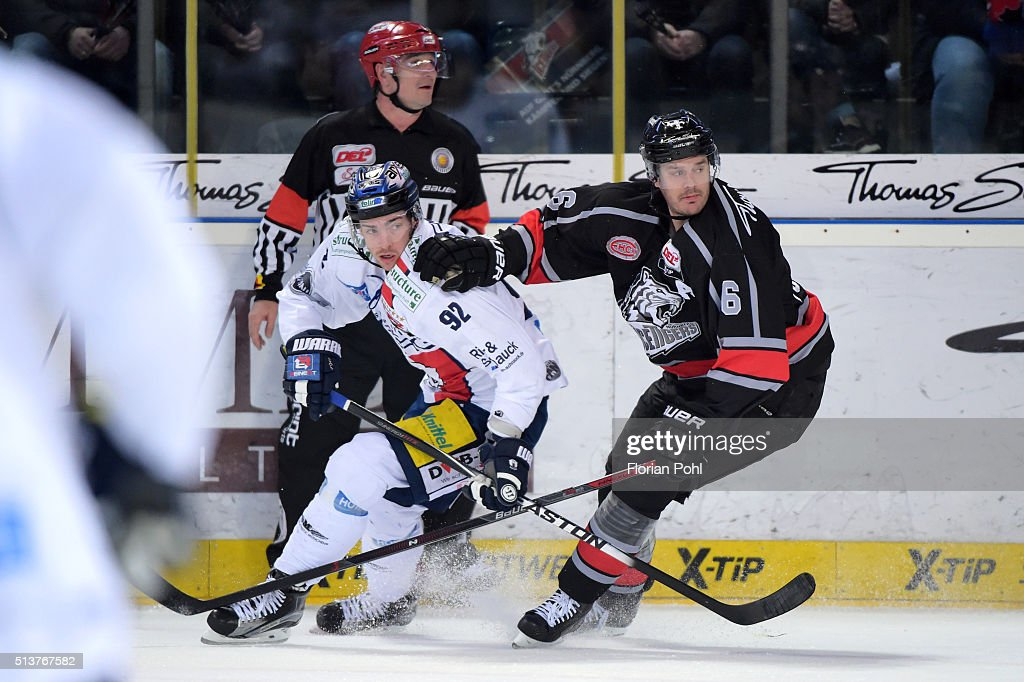 Marcel Noebels of the Eisbaeren Berlin and Kurtis Foster of the Thomas Sabo Ice Tigers Nuernberg during the game between the Thomas Sabo Ice Tigers...
