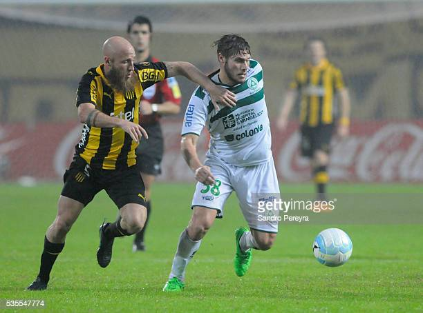 Marcel Novick of Penarol and German Rivero of Plaza Colonia fight for the ball during a match between Penarol and Plaza Colonia as part of Campeonato...