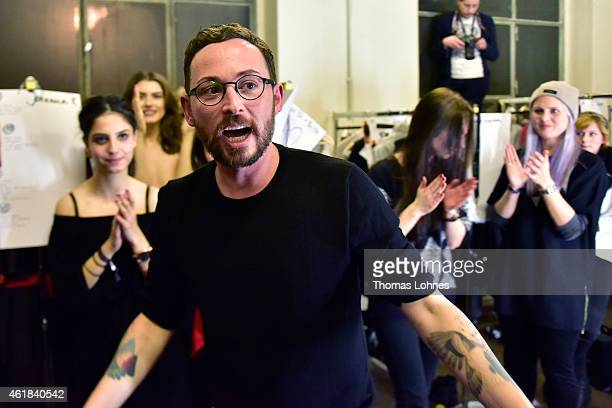 Marcel Ostertag and models seen backstage ahead of the Marcel Ostertag show at Heeresbaeckerei on January 20 2015 in Berlin Germany