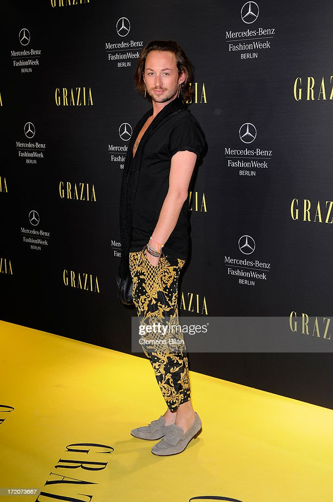 Marcel Ostertag attends the Mercedes-Benz Fashion Week Berlin Spring/Summer 2014 Preview Show by Grazia at the Brandenburg Gate on July 1, 2013 in Berlin, Germany.