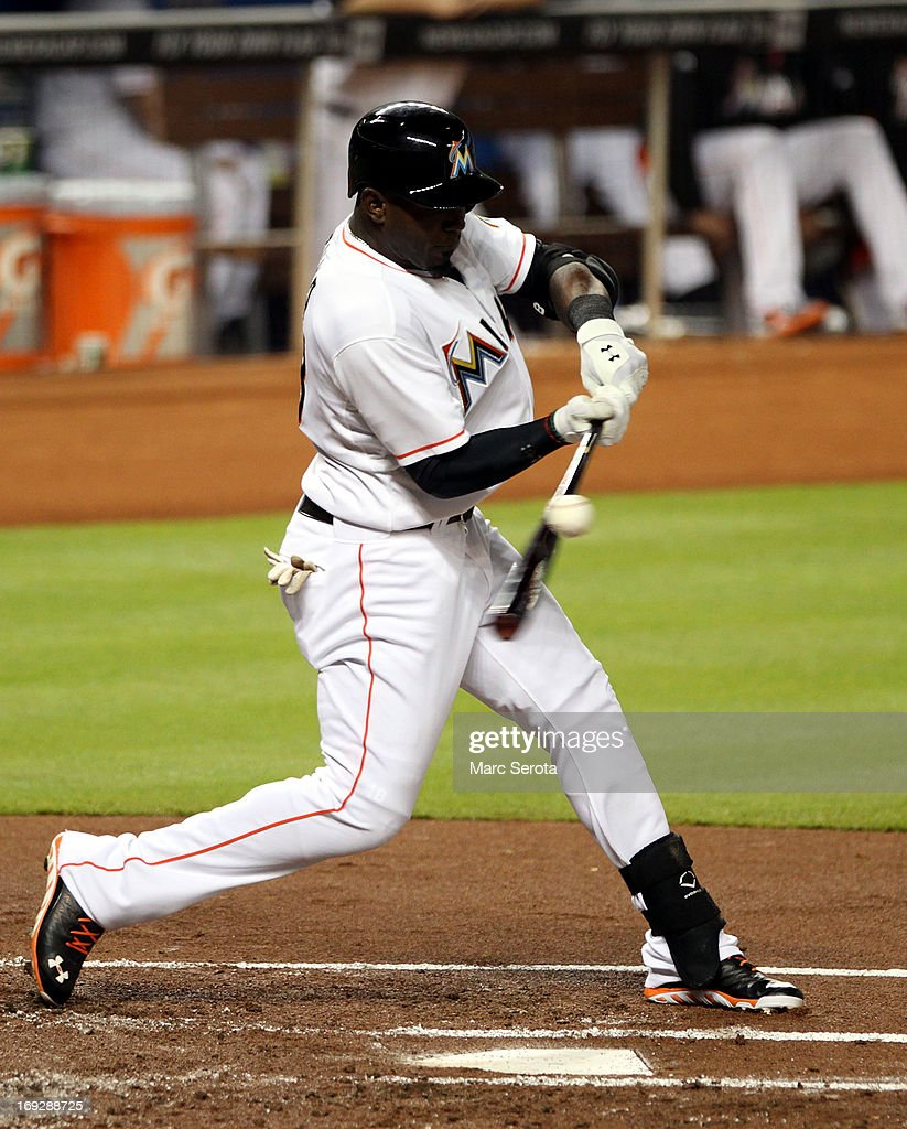 Marcel Ozuna #48 of the Miami Marlins gets a base hit against the Philadelphia Phillies in the second inning at Marlins Park on May 22, 2013 in Miami, Florida.