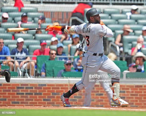 Marcel Ozuna of the Miami Marlins hits a first inning threerun home run against the Atlanta Braves at SunTrust Park on August 6 2017 in Atlanta...