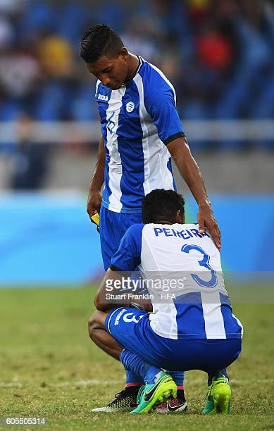 Marcel Pereira and Bryan Acosta of Honduras look dejected during the Olympic Men's Football match between Honduras and Portugal at Olympic Stadium on...