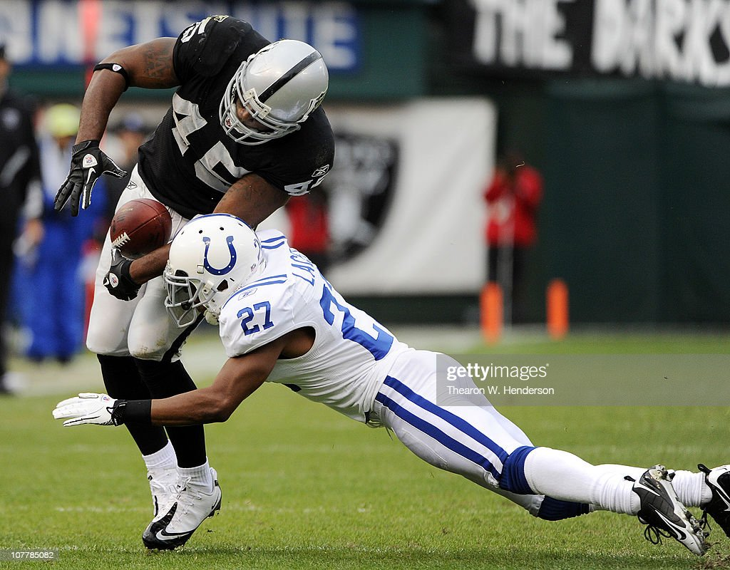 Marcel Reece #45 of the Oakland Raiders bounces off the tackle of Jacob Lacey #27 of the Indianapolis Colts during an NFL football game at The Oakland-Alameda County Coliseum December 26, 2010 in Oakland, California. The Colts won the game 31-26.