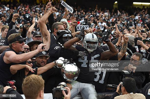 Marcel Reece of the Oakland Raiders celebrates a third quarter touchdown against the San Francisco 49ers at Oco Coliseum on December 7 2014 in...