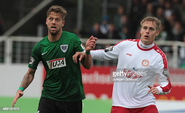 Marcel Reichwein of Muenster and Lars Bender of Cologne wait for a corner ball during the Third League match between Preussen Muenster and Fortuna...