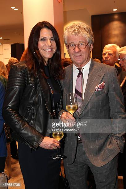 Marcel Reif and his wife Dr Marion Kiechle attend the Hirmer store reopening on October 22 2014 in Munich Germany