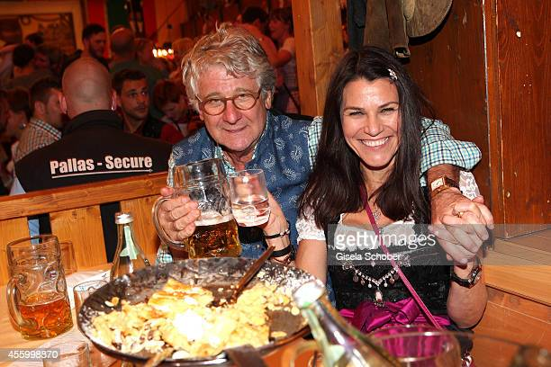 Marcel Reif and his wife Dr Marion Kiechle during Oktoberfest at Schuetzenzelt Theresienwiese on September 23 2014 in Munich Germany