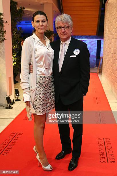 Marcel Reif and his wife Marion Kiechle arrive the red carpet during the German Media Award 2014 on January 23 2015 in BadenBaden Germany