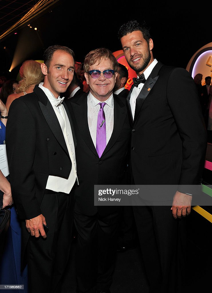 Marcel Remus (L) and Elton John (R) attend the 15th Annual White Tie and Tiara Ball to Benefit Elton John AIDS Foundation in Association with Chopard at Woodside on June 27, 2013 in Windsor, England. No sales to online/digital media worldwide until the 14th of July. No sales before July 14th, 2013 in UK, Spain, Switzerland, Mexico, Dubai, Russia, Serbia, Bulgaria, Turkey, Argentina, Chile, Peru, Ecuador, Colombia, Venezuela, Puerto Rico, Dominican Republic, Greece, Canada, Thailand, Indonesia, Morocco, Malaysia, India, Pakistan, Nigeria. All pictures are for editorial use only and mention of 'Chopard' and 'The Elton John Aids Foundation' are compulsory. No sales ever to Ok, Now, Closer, Reveal, Heat, Look or Grazia magazines in the United Kingdom. No sales ever to any jewellers or watchmakers other than Chopard.