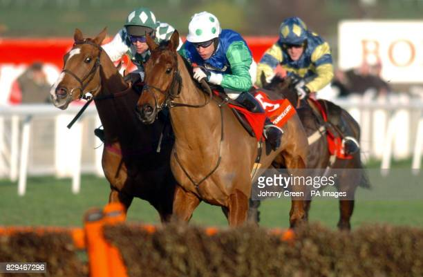 Marcel ridden by Timmy Murphy leads from Chilling Place ridden by Richard Johnson and It's Just Harry ridden by Tony McCoy
