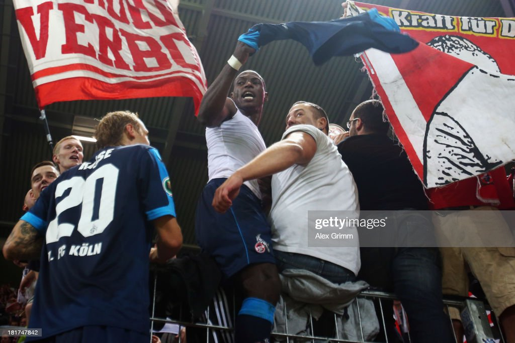 <a gi-track='captionPersonalityLinkClicked' href=/galleries/search?phrase=Marcel+Risse&family=editorial&specificpeople=4331527 ng-click='$event.stopPropagation()'>Marcel Risse</a> and Anthony Ujah of Koeln celebrate with the fans after the DFB Cup second round match between 1. FSV Mainz 05 and 1. FC Koeln at Coface Arena on September 24, 2013 in Mainz, Germany.