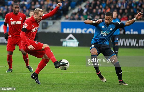 Marcel Risse of FC Koeln has a shot at goal blocked by Jeremy Toljan of TSG 1899 Hoffenheim during the Bundesliga match between TSG 1899 Hoffenheim...