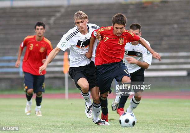 Marcel Risse of Germany and Jordi Alba of Spain fight for the ball during the UEFA European U19 Championship match between Germany and Spain at the...