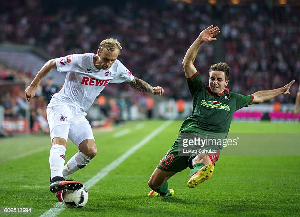 Marcel Risse of Koeln and Christian Gunter of Freiburg in action during the Bundesliga match between 1 FC Koeln and SC Freiburg at...