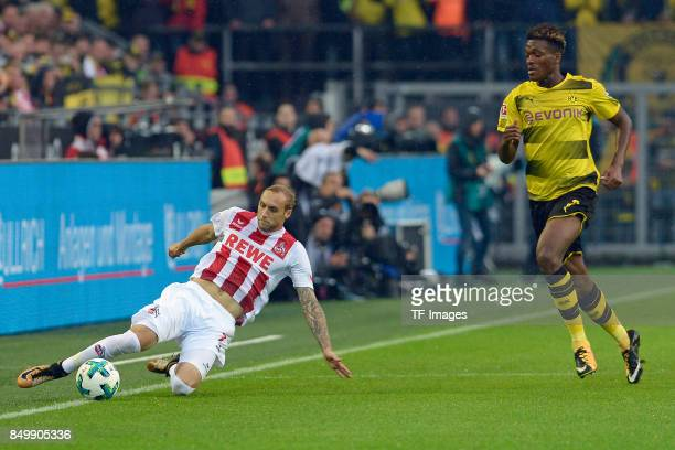 Marcel Risse of Koeln and DanAxel Zagadou of Dortmund battle for the ball during the Bundesliga match between Borussia Dortmund and 1 FC Koeln at the...