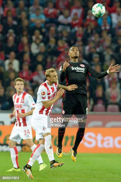 Marcel Risse of Koeln and KevinPrince Boateng of Frankfurt battle for the ball during the Bundesliga match between 1 FC Koeln and Eintracht Frankfurt...