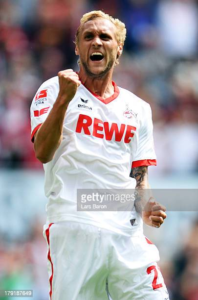 Marcel Risse of Koeln celebrates after scoring his teams third goal during the Second Bundesliga match between 1 FC Koeln and Erzgebirge Aue at...