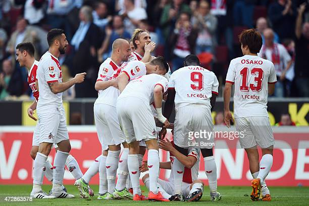 Marcel Risse of Koeln celebrates her team's first goal with team mates during the Bundesliga match between 1 FC Koeln and FC Schalke 04 at...
