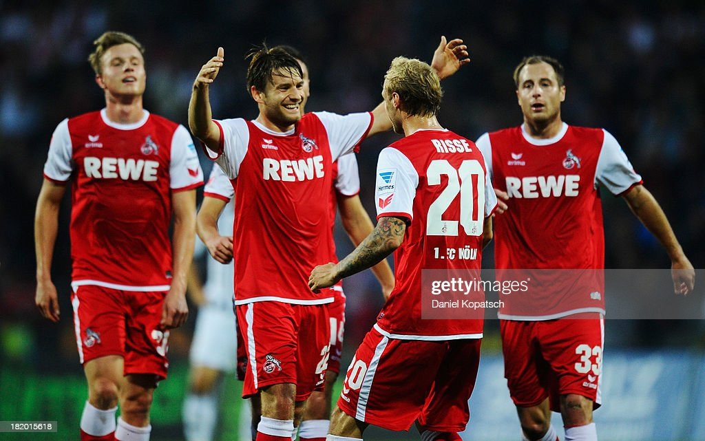 Marcel Risse of Koeln celebrates his team's first goal with team mates during the second Bundesliga match between VfR Aalen and 1 FC Koeln at...