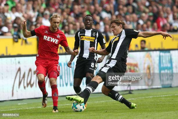 Marcel Risse of Koeln Denis Zakaria of Moenchengladbach and Jannik Vestergaard of Moenchengladbach during the Bundesliga match between Borussia...